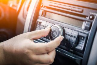 woman turning button of radio
